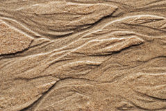 Muster im Gezeiten- Sand Stockfotografie