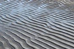 Muster im Strandsand Lizenzfreies Stockbild