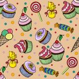 Muster mit kleinem Kuchen und Süßigkeit Lizenzfreie Stockfotos