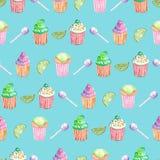 Muster mit Muffins, Kalk und Süßigkeit Stockbilder
