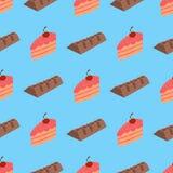 Muster mit Schokolade und Kuchen auf blauem Hintergrund Lizenzfreies Stockfoto