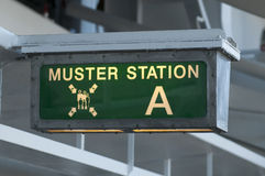 Muster station sign directing passengers to the life boats Stock Image