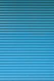 Muster von Blauem rollen oben Tür Lizenzfreies Stockfoto