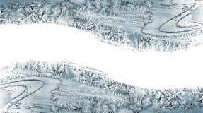 Muster von den Eiskristallen auf einer Fensterscheibe Lizenzfreie Stockbilder