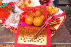 Muster von Joss Paper und orange, chinesisches oder neues Mondjahr für Lizenzfreie Stockbilder