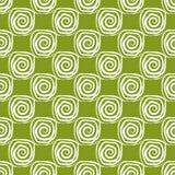 Muster von weißen Spiralen auf einem grünen Hintergrund Stockbild