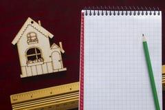 Musterhaus und Ziehwerkzeuge Stockfoto