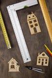 Musterhaus und Ziehwerkzeuge Stockbild