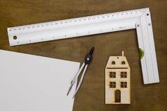 Musterhaus und Ziehwerkzeuge Stockbilder