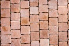 Musterhintergrund des Ziegelsteinblockgehwegs Stockbild