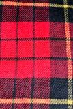 Musterschottenstoffwollbeschaffenheitshintergrund des roten Quadrats Stockfotos