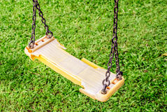 Musty hanging swing seats on park Stock Photo