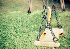 Musty hanging swing seats on park Royalty Free Stock Photo
