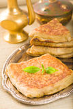 Mutabbaq a popular arab food where bread if stuffed with meat Royalty Free Stock Images