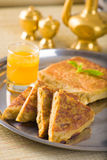 Mutabbaq a popular arab ramadan food where bread if stuffed with Stock Images