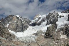 Mutamento climatico sull'alpe italiana, un ghiacciaio di fusione Immagine Stock