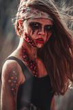 Mutant girl portrait in wounds and ulcers with nails in her head. On her head is bandage stock photos