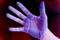 Mutant hand. This is an image of inverted coloured black hand, with a hint of blended background stock image
