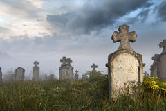 The mute army. Morning quarters of some very old tombstones in a very old abandoned cemetery in Hungary. It was a stormy day Stock Image