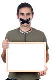 Mute boy holding poster Royalty Free Stock Images