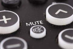 Mute Button. A closeup view of the mute button on a TV remote control Stock Image