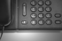 Mute button on telephone. Focus at mute button on telephone Stock Image