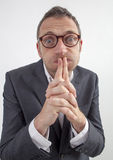 Mute manager puffing his cheeks for corporate silence or taboo. Expressive corporate man concept - funny middle age businessman with eyeglasses puffing his Stock Photo
