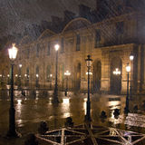 The Mute Streetlamp. As I was walking back to my hotel at 1 a.m. on a January night, a light Parisian drizzle turned into a flogging deluge. I hid under the Stock Photo
