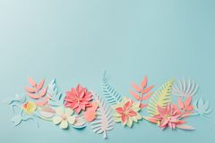 Muted color colorful flower composition - handmade papercraft flowers and leaves on pastel blue background, sprin, summer, easter. Muted color colorful flower royalty free stock images