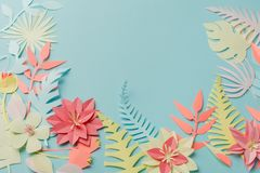 Muted color colorful flower composition - handmade papercraft flowers and leaves on pastel blue background, sprin, summer, easter. Muted color colorful flower stock image