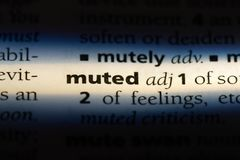 Muted. Word in a dictionary.  concept stock images