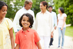 Muti-Generation Indian Family Walking In Countryside Royalty Free Stock Photos