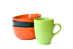 Muticolored bowls and mug Stock Photography