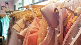Mutiple colors dress on hangers. Mutiple colors dress hanging on hangers Stock Images