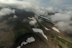 Mutnovsky is a complex volcano located in the southern part of Kamchatka Peninsula. Stock Photo