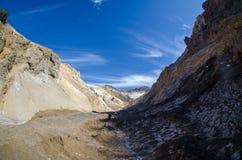 Mutnovsky volcano. Route in crater of Mutnovsky volcano in summer Royalty Free Stock Image
