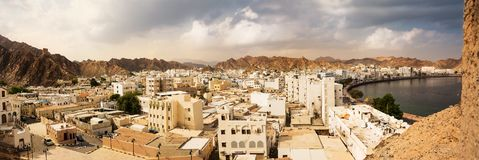 Mutrah waterfront with Mosque in Muscat at sunset and Corniche with nobody stock images