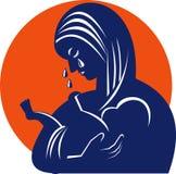 Mutter in den Rissen mit Schätzchenkind Lizenzfreie Stockbilder