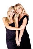 Mutter und Tochter auf weißem Hintergrund Lizenzfreie Stockbilder