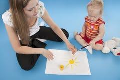 Mutter- und Tochterzeichnung Stockfotos