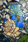 Mutter von Buddha auf Buntglas Stockfotografie