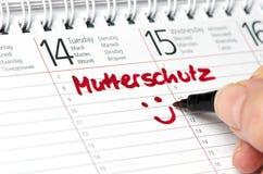 Mutterschutz geschrieben in einen Kalender Stockfotos