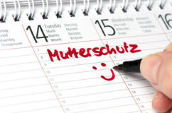 Mutterschutz scritto in un calendario Fotografie Stock