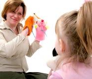 Mutterspiel mit Tochter Stockbild