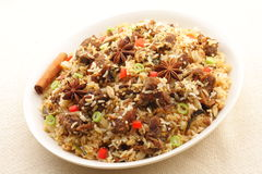 Mutton biriyani. It is a medley of rice, meat. The rice is browned in oil and then mixed with vegetables, egg, chicken , nuts, fruits etc. Basmati Rice is Stock Photography