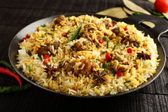 Mutton biriyani or pilaf served in cast iron cookware Stock Image