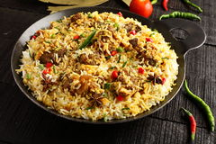 Mutton biriyani or pilaf served in cast iron cookware Royalty Free Stock Images