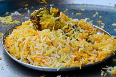Mutton Biryani. Biryani, biriani, or beriani is a set of rice-based foods made with spices, rice (usually basmati) and meat, fish, eggs or vegetables stock photo