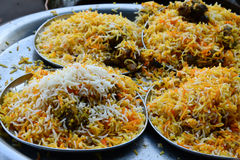 Mutton Biryani. Biryani, biriani, or beriani is a set of rice-based foods made with spices, rice (usually basmati) and meat, fish, eggs or vegetables royalty free stock photography
