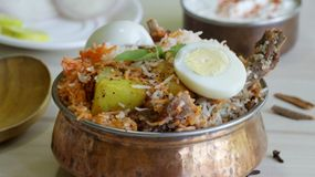 Mutton Biryani is a famous rice dish from India. Mutton Biryani is a famous rice based dish which is usually prepared in special occasions. Rice and mutton is Stock Photos